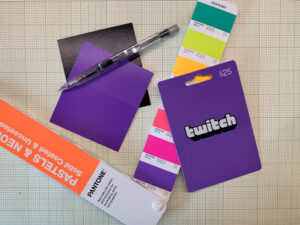 A pantone color strip and a printed gift card (Twitch).